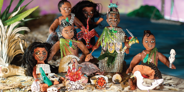 Six handmade model figures sitting around a fire, with two birds in front. One figure is holding a club.