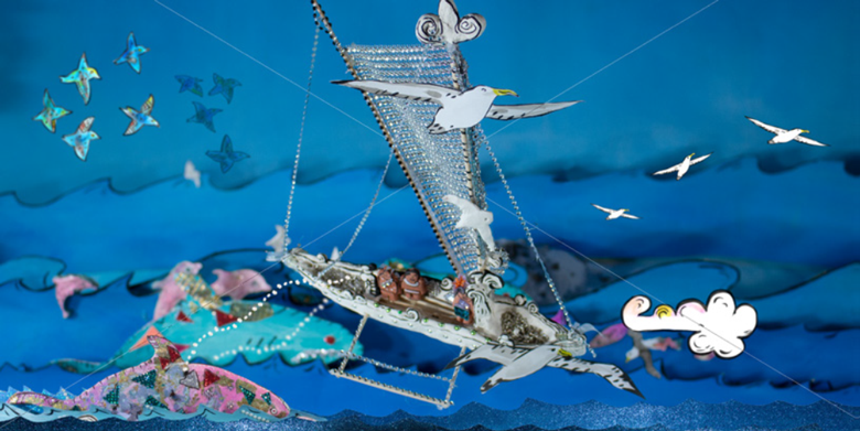 A handmade model canoe surrounded by sea, with two sharks in front, and white and blue birds flying over.